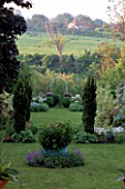 FASTIGIATE YEWS: GOTHIC ARCH DIVIDES CULTIVATED AND WILD GARDEN.THE WHITE HOUSE/ELISABETH WOODHOUSE