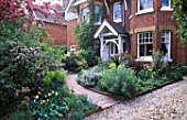 FRONT GARDEN DESIGNED BY JUDITH SHARP WITH CURVED PATH TULIP DOUGLAS BADER EUPHORBIAS