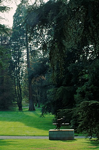 SCULPTURE_BY_NAG_ARNOLDI_IN_FG_BESIDE_GIANT_CEDARS_IN_THE_ARBORETUM_MAINAU__LAKE_CONSTANCE
