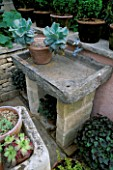 SHALLOW SINK WITH BIRD TAP ACTS AS BIRD BATH. DESIGNER BUNNY GUINNESS/DGAA HOMELIFE GARDEN CHELSEA 97