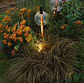 GLOBES UP LIGHT BY GARDEN & SECURITY LIGHTING THRUST UPWARDS THROUGH ACHILLEA AND ARUNDINARIA IN THE NATURAL AND ORIENTAL WATER GARDENS  HAMPTON COURT 97