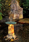CERAMIC FOUNTAIN AND THRONE BY EMMA LUSH LIT UP AT NIGHT
