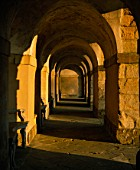 GOLDEN SUNLIGHT ON CONCENTRIC STONE ARCHES AT ROUSHAM LANDSCAPE GARDENS  OXFORDSHIRE.( AS 2076)