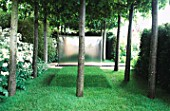 MODERN METAL FOUNTAIN WITHIN TWO PLEACHED LIME BOSQUETS. EVENING STANDARD GARDEN  CHELSEA 98. DESIGNER ARABELLA LENNOX-BOYD.