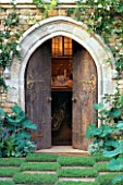 TROMPE LOEIL PAINTING BEHIND WOODEN DOORS AND STONE ARCH. CHELSEA 98