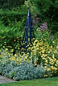 BLUE TRIPOD SURROUNDED BY ANTHEMIS TINCTORIA E C BUXTON AND ARTEMISIA LUDOVICIANA VALERIE FINNIS. ARROW COTTAGE  HEREFORDSHIRE
