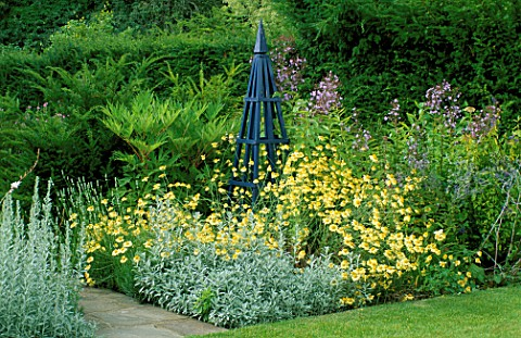 BLUE_TRIPOD_SURROUNDED_BY_ANTHEMIS_TINCTORIA_E_C_BUXTON_AND_ARTEMISIA_LUDOVICIANA_VALERIE_FINNIS_ARR