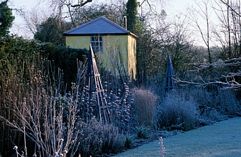 THE_SUMMERHOUSE_GARDEN_AT_ARROW_COTTAGE_IN_THE_FROST_BLUE_WOODEN_TRIPOD_IN_FOREGROUND_AND_THE_TOWER_