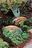 GARDEN OF SUCCULENTS IN ROBERT CLARKS GARDEN DESIGNED BY ARCHIE DAYS: CRUSHED LAVA  ECHEVERIAS  SEDUMS AND ALOES