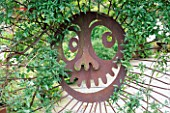 A FACE ON A METAL GATE BY ARTIST MARK BULLWINKLE IN ROBERT CLARKS SAN FRANCISCO GARDEN