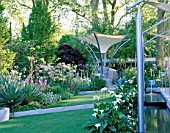 MODERN GARDEN CONTAINING ARCHITECTURAL FORM AND CANVAS CANOPY WITH STEPPED LAWN AND CANAL. TELEGRAPH REFLECTIVE GARDEN  CHELSEA 99.