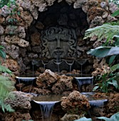 WATER FEATURE: WATER CASCADES FROM APOLLO INTO GIANT CLAM SHELLS AND OVER VOLCANIC TUFA ROCKS. GROTTO. THE CASCADE GARDEN  MYLES CHALLIS/ PARAMOUNT PLANT  CHELSEA 99