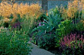 PERENNIAL PLANTING IN WALLED GARDEN BY CHRISTOPHER BRADLEY-HOLE: STIPA GIGANTEA  SALVIA PURPLE RAIN  EREMERUS CLEOPATRA  AGASTACHE FOENICULUM AND CYNARA CARDUNCULUS