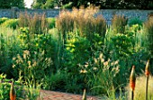 PERENNIAL PLANTING IN WALLED GARDEN BY CHRISTOPHER BRADLEY-HOLE: ANGELICA ARCHANGELICA AND CALAMAGROSTIS X ACUTILFORA KARL FOERSTER
