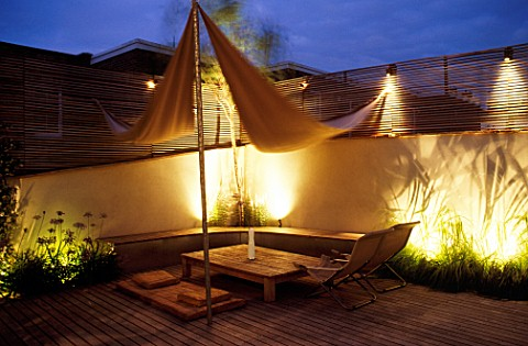 ROOF_GARDEN_TIMBER_DECKING__AWNING__TABLE__DECKCHAIRS__SLATTED_TRELLIS__KAUNA_RUSH_MATTRESS__ALL_LIT