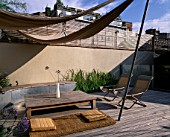 ROOF GARDEN: TIMBER DECKING  AWNING  DECKCHAIRS  SLATTED TRELLIS  KAUNA RUSH MATTRESS AND FOUNTAIN GRASS (PENNISETUM ALOPECUROIDES): DESIGNERS PAUL THOMPSON/TREVYN MCDOWELL