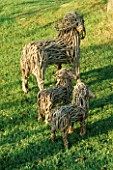 SHEEP MAY SAFELY GRAZE : WICKER SCULPTURES OF A EWE AND TWO LAMBS. NYEWOOD HOUSE   WEST SUSSEX.