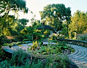 VIEW OF KITCHEN TERRACE LILY POOL IN ALL ITS SUMPTUOUS DETAIL - LOTUS  CANNA AND WATER LETTUCE. DESIGNER: JAMES VAN SWEDEN. AMERICA