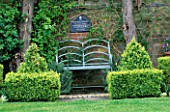METAL BENCH AND BOX TOPIARY SHAPES. LORD LEYCESTER HOSPITAL GARDEN  WARWICK