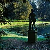 A SATYR BECKONS TOWARDS THE WOODS IN KENTS VALE OF VENUS  ROUSHAM LANDSCAPE GARDEN  OXFORDSHIRE