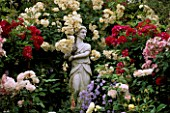 CAROLYN HUBBLES GARDEN  SHROPSHIRE: THE VALENTINE GARDEN WITH ITALIAN MARBLE STATUE AND ROSES