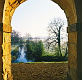 VIEW OF THE RIVER CHERWELL FROM THE 7 ARCHED PORTICO CALLED PRAENESTE  ROUSHAM LANDSCAPE GARDEN  OXFORDSHIRE