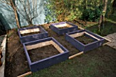 WOODEN SCAFFOLDING BOARDS USED TO MAKE RAISED BEDS FOR THE DECORATIVE CHILDRENS POTAGER PAINTED PALE PURPLE