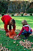 CLARE AND HARRIET PREPARE TP PLANT OUT THE BULBS OF NARCISSUS YELLOW CHEERFULNESS