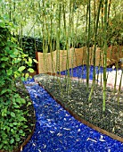 GLASS GARDEN: BLUE GLASS AND GREEN MARBLES ACT AS MULCH BENEATH BAMBOOS WITH ROPE FENCING: DESIGN BY ANDY CAO AND STEPHEN JERROM  USA
