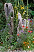 NATURAL DRIFTWOOD SCULPTURE FENCE IN MARNEY HALLS ROOTS AND SHOOTS GARDEN  HAMPTON COURT 2001