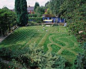 CHILDRENS SUMMER PARTY: THE LAWN PREPARED FOR PARTY WITH RUNNING TRACK   SILVER BIRD BATH  GRASS MAZE AND BOULES AREA