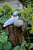 WOODEN SEAGULL ON A POST SURROUNDED BY ALCHEMILLA MOLLIS IN DAVID AND MARIE CHASES GARDEN  HAMPSHIRE