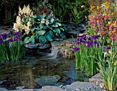 POND AND WATERFALL SURROUNDED BY PRIMULAS  IRIS ENSATA AND HOSTA SIEBOLDIANA ELEGANS - HAMPTON COURT 2001/PAUL DYER