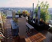 AFRICAN THEMED ROOF TERRACE:IROKO DECKING    ZINC-WRAPPED TABLE WITH KALANCHOE THYRSIFLORA  STAINLESS STEEL  CHAIRS   STEEL SHIELD SCULPTURE & PHYLLOSTACHYS.  DESIGN: S. WOODHAMS