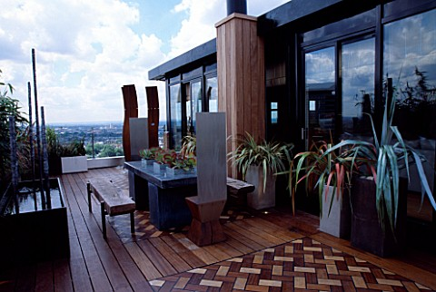 AFRICAN_THEMED_ROOF_TERRACEIROKO_DECKING__HERRINGBONE_BRICK_DESIGN_PANELS_ZINCWRAPPED_TABLE__STAINLE