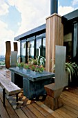 AFRICAN THEMED ROOF TERRACE: SLIDING SKYLIGHT WITH PERIMETER GALVANISED CONTAINERS.  IROKO DECKING.   DESIGN: S. WOODHAMS