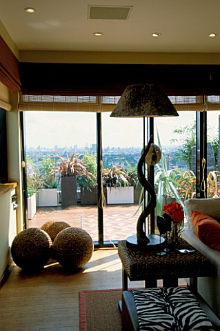 INTERIOR_OF_AFRICAN_THEMED_MEDIA_ROOM__OVERLOOKING_THE_18TH_FLOOR_ROOF_GARDEN_INTERIORS_DESIGNED_BY_