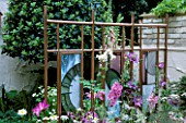 COPPER SCREEN BY STUART JONES WITH STAINED GLASS BY CHARLOTTE MORRISON. CHELSEA 2002/CHLOE WOOD/TAMSIN WOODHOUSE