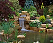 WATERFALL IN GARDEN DESIGNED BY BRIAN AUGHTON AND TERESSA POTTER. PLANTS BY TARLETON SPECIMEN PLANTS