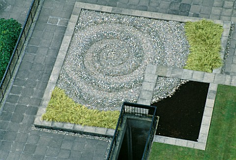 THE_DROP___A_HUGE_SPIRAL_WATER_DROPLET_MADE_FROM_100S_OF_PEBBLES_CEMENTED_BY_HAND__BY_TONY_HEYWOOD_O