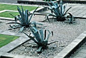 GIANT AGAVES IN GRAVEL AT THE WATER GARDENS  LONDON. GARDEN CREATED BY TONY HEYWOOD OF CONCEPTUAL GARDENS