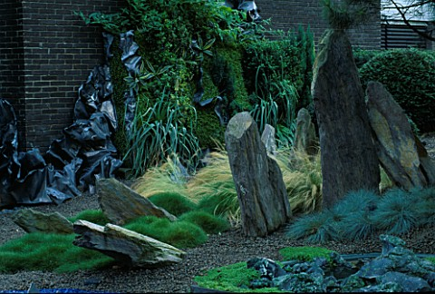 HELTER_SKELTER___GARDEN_CREATED_BY_TONY_HEYWOOD_OF_CONCEPTUAL_GARDENS__LONDON_FESTUCA_GLAUCA__ROCKS_
