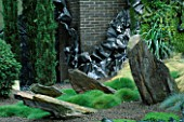 HELTER SKELTER   GARDEN CREATED BY TONY HEYWOOD OF CONCEPTUAL GARDENS  LONDON: ROCKS  TWISTED LEAD AND GRASSES