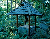 JAPANESE BELL TOWER IN THE WOODLAND. DESIGNERS: ILGA JANSONS AND MIKE DRYFOOS  SEATTLE  USA