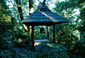 THE JAPANESE BELL TOWER IN THE WOODLAND. DESIGNERS: ILGA JANSONS AND MIKE DRYFOOS  SEATTLE  USA