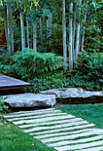 VIEW ALONG FRONT WOODEN PATH WITH LAWN   ROCKS  DECKING AND ASPENS. DESIGNER BOB SWAIN  SEATTLE  USA