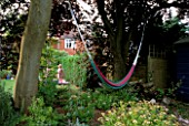 A HAMMOCK STRUNG BETWEEN TWO TREES IN ROSEMARY PEARSONS GARDEN  READING