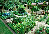 FAMILY POTAGER BY CLARE MATTHEWS: GRAVEL  CABBAGES  CLIPPED BOX AND BAY  APPLES  WOODEN OBELISKS AND A SUMMERHOUSE
