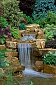 WATERFALL IN GARDEN DESIGNED BY BRIAN AUGHTON AND TERESSA POTTER  TATTON PARK 2002. PLANTS BY TARLETON SPECIMEN PLANTS