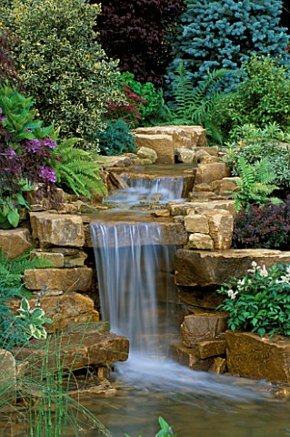 WATERFALL_IN_GARDEN_DESIGNED_BY_BRIAN_AUGHTON_AND_TERESSA_POTTER__TATTON_PARK_2002_PLANTS_BY_TARLETO